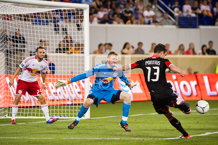 New York Red Bulls goalkeeper Ryan Meara (18) defends the shot of Chris Pontius (13) of DC United. The New York Red Bulls defeated DC United 3-2 during a Major League Soccer (MLS) match at Red Bull Arena in Harrison, NJ, on June 24, 2012.