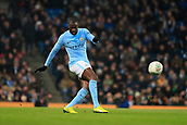 9th January 2018, Etihad Stadium, Manchester, England; Carabao Cup football, semi-final, 1st leg, Manchester City versus Bristol City; Yaya Toure of Manchester City crosses the ball