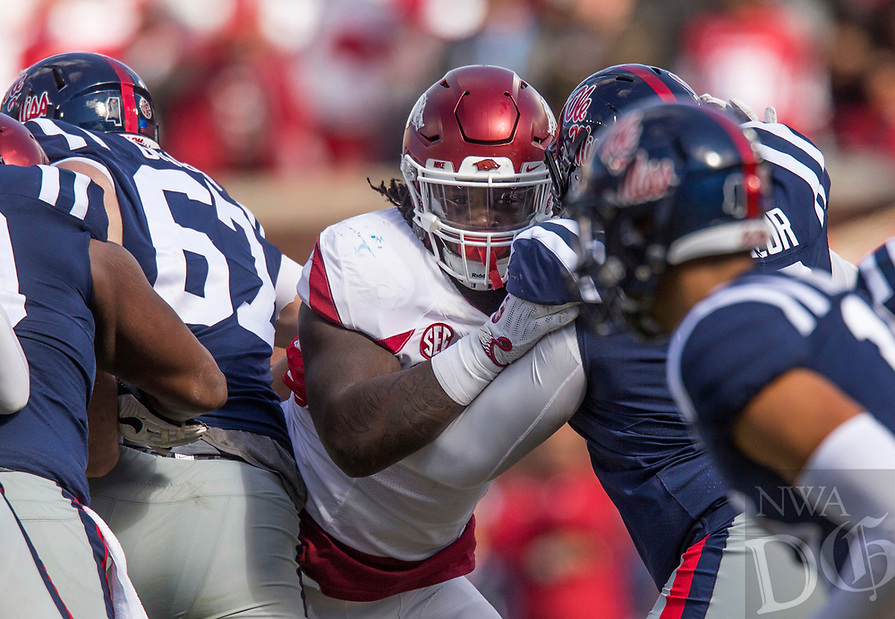 Hawgs Illustrated/BEN GOFF <br /> McTelvin Agim, Arkansas defensive end, blocks Rod Taylor, Ole Miss right tackle, in the fourth quarter Saturday, Oct. 28, 2017, at Vaught-Hemingway Stadium in Oxford, Miss.