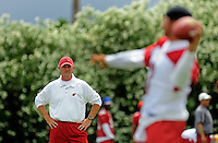 May 20, 2009; Tempe, AZ, USA; Arizona Cardinals head coach Ken Whisenhunt (left) looks on during organized team activities at the Cardinals practice facility. Mandatory Credit: Mark J. Rebilas-
