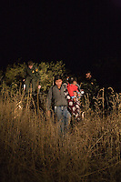 Family caught by the Border Patrol after crossing the border in Nogales, AZ.12/10/05.photos: Hector Emanuel