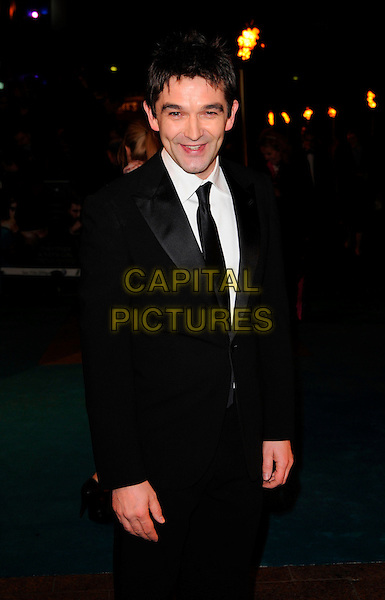 "JUSTIN CHADWICK.""The Other Boleyn Girl"" Royal Film Premiere, Odeon Cinema, Leicester Square, London, England..February 19th, 2008.half length 3/4 black suit.CAP/CAN.©Can Nguyen/Capital Pictures."