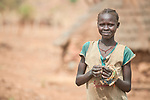 A girl in Lugi, a village in the Nuba Mountains of Sudan. The area is controlled by the Sudan People's Liberation Movement-North, and frequently attacked by the military of Sudan. The church has sponsored wells, schools and health care facilities throughout the war-torn region.