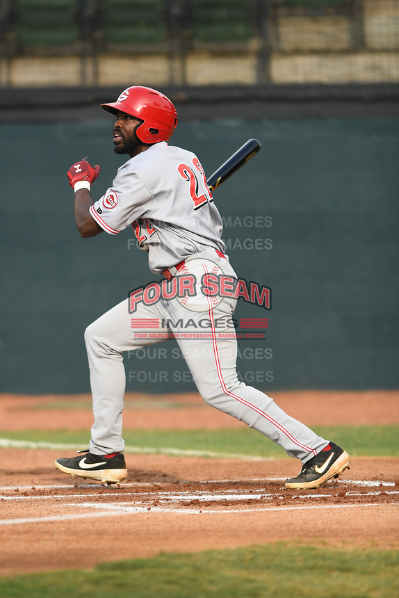 AJ Bumpass (22) of the Greeneville Reds follows through on his swing against the Bristol Pirates at Boyce Cox Field on July 31, 2019 in Bristol, Virginia. The Pirates defeated the Reds 13-3. (Tracy Proffitt/Four Seam Images)