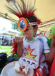 Demetrius Gensaw, 8, eats strawberry shortcake at the annual Stewart Father's Day Pow Wow at the historic Stewart Indian Facility in Carson City, Nev., on Sunday, June 16, 2013.<br />