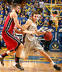 BROOKINGS, SD - MARCH 1:  Brayden Carlson #12 from South Dakota State University tries to drive against Adam Thoseby #13 from the University of South Dakota in the second half or their game Saturday afternoon at Frost Arena in Brookings. (Photo by Dave Eggen/Inertia)