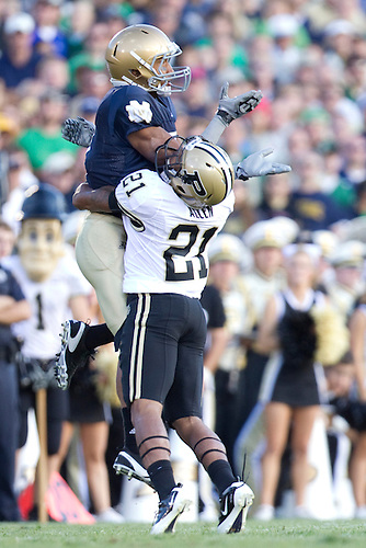 Purdue cornerback Ricardo Allen (#21) inteferes on pass to Notre Dame wide receiver TJ Jones (#7) in game action during NCAA football game between the Notre Dame Fighting Irish and the Purdue Boilermakers.  Notre Dame defeated Purdue 23-12 in game at Notre Dame Stadium in South Bend, Indiana.
