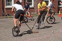 Governor's  Island, NY -  4 September 2010 Unicyclists play Unicycle Hockey (Unicycle Polo) during the New York City Unicycle Festival on Governor's Island.