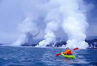Ocean kayaking by the Kilauea volcanoe lava flow into the ocean, Hawaii
