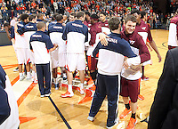 Virginia  and Virginia Tech players greet each other before the start of the game Saturday in Charlottesville, VA. Virginia won 65-45. Photo/The Daily Progress/Andrew Shurtleff