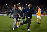 Two members of the crows run onto the field during play. San Jose Earthquakes defeated Houston Dynamo 3-2 at Buck Shaw Stadium in Santa Clara, California on March 28th, 2009.