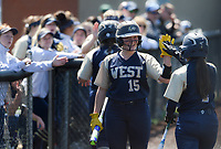 NWA Democrat-Gazette/CHARLIE KAIJO Bentonville West High School Ryen Rassi (15) high-fives Bentonville West High School Hallie Wacaser (1) after scoring a run during a softball game, Friday, May 10, 2019 at Tiger Athletic Complex at Bentonville High School in Bentonville. Bentonville West High School defeated Bryant High School 5-3