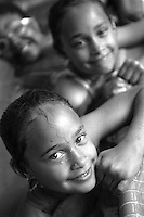 Portrait of two smiling young girls in a swimming pool.