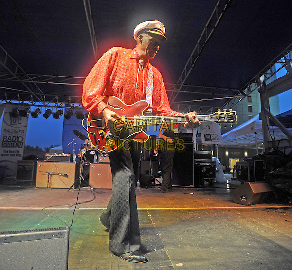 CHUCK BERRY.Performs live at the Raleigh Convention Center, Raleigh, North Carolina, USA..September 5th, 2008.full length stage concert live gig performance music guitar grey gray trousers red orange shirt white hat .CAP/ADM/MOO.© Moose/AdMedia/Capital Pictures.
