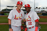Palm Beach Cardinals third baseman Ildemaro Vargas (18) and outfielder Starlin Rodriguez (12) pose for a photo before a game against the Bradenton Marauders on April 8, 2014 at McKechnie Field in Bradenton, Florida.  Bradenton defeated Palm Beach 4-3.  (Mike Janes/Four Seam Images)