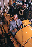 American businessman Tony Hulman, who bought the Indianapolis Motor Speedway in 1945, poses in an antique racing car at the Indianapolis Motor Speedway Museum, October 10, 1973. Photo by John G. Zimmerman.