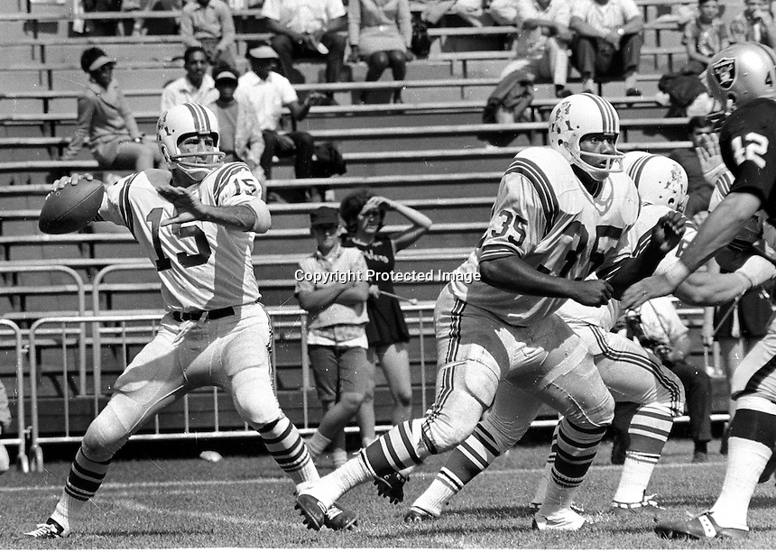 Raiders vs the Patriots..(1969)..Quarterback Babe Parilli passing against the Raiders (1967 photo/Ron Riesterer)