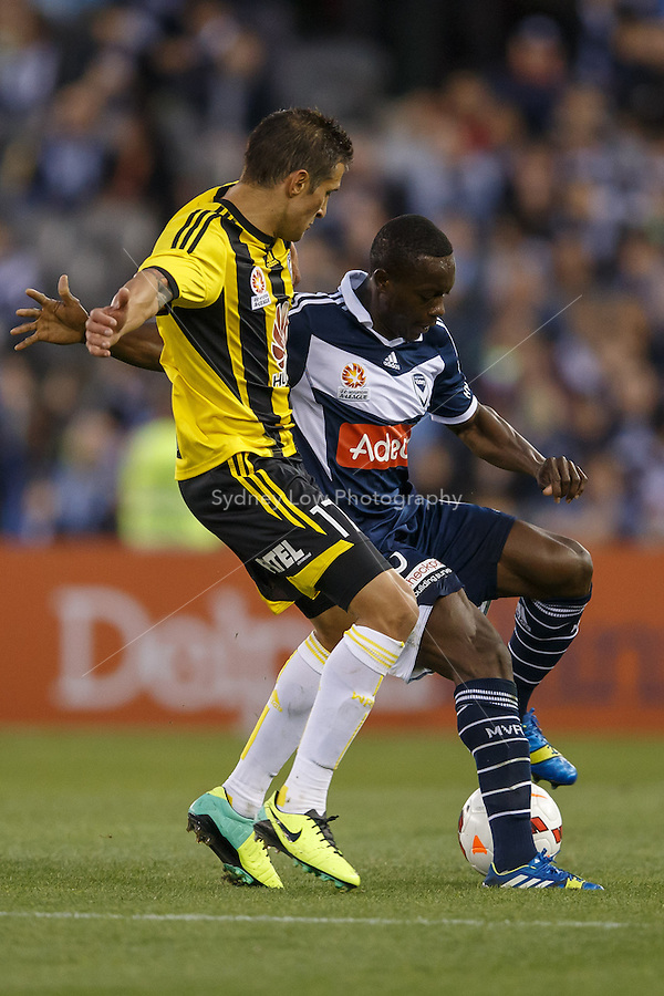 Adama TRAORE of the Victory and Vince LIA of the Phoenix fight for the ball in the round four match between Melbourne Victory and Wellington Phoenix in the Australian Hyundai A-League 2013-24 season at Etihad Stadium, Melbourne, Australia.<br /> This image is not for sale. Please visit zumapress.com for image licensing.