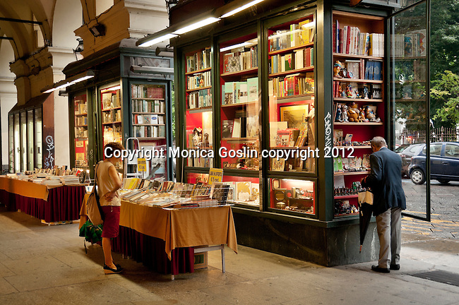 A book store under the arcaded street around the Piazza Carlo Felice in Turin, Italy. Turin, Italy is full of arcaded streets, many with bookstores made into the walls between the arches