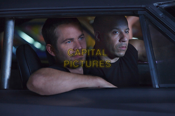 Paul Walker, Vin Diesel<br /> in Fast Five (2011) <br /> *Filmstill - Editorial Use Only*<br /> CAP/FB<br /> Image supplied by Capital Pictures