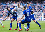 Gareth Bale (C) of Real Madrid fights for the ball with Manuel Alejandro Garcia Sanchez, Manu Garcia (L), and Alexis Ruano Delgado of Deportivo Alaves during the La Liga 2017-18 match between Real Madrid and Deportivo Alaves at Santiago Bernabeu Stadium on February 24 2018 in Madrid, Spain. Photo by Diego Souto / Power Sport Images