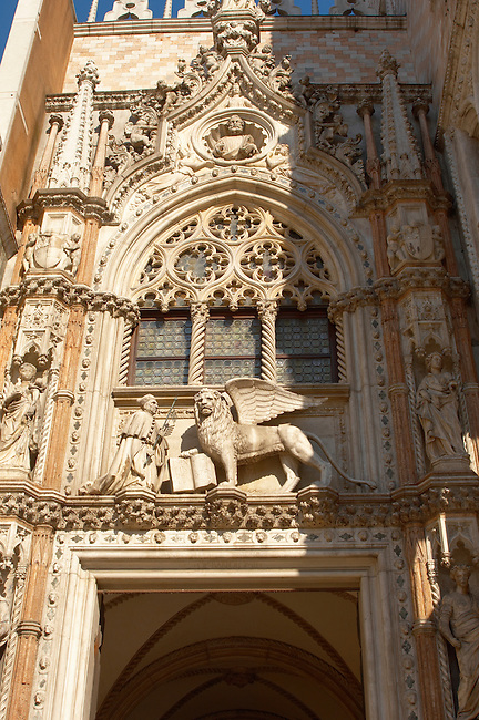 Sculpture of a Dogue and the Lionb of Venice above a door of Doges Palace - Venice Italy