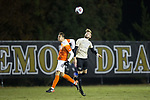 Diego Campos (10) of the Clemson Tigers battles for a jump ball with Sam Raben (26) of the Wake Forest Demon Deacons during first half action at Spry Soccer Stadium on November 8, 2017 in Winston-Salem, North Carolina.  The Demon Deacons defeated the Tigers 2-1.  (Brian Westerholt/Sports On Film)