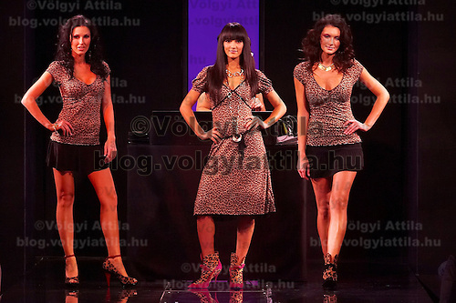 Hungarian celebrity Zita Debreczeni (C) with other models presents collections by Pussy Deluxe and Vive Maria during the opening underwear fashion show of the new event hall called Show-Room in Budapest, Hungary on October 26, 2007. ATTILA VOLGYI