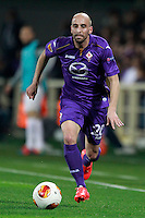 Calcio, ritorno degli ottavi di finale di Europa League: Fiorentina vs Juventus. Firenze, stadio Artemio Franchi, 20 marzo 2014. <br /> Fiorentina midfielder Borja Valero, of Spain, in action during the Europa League round of 16 second leg football match between Fiorentina and Juventus at Florence's Artemio Franchi stadium, 20 March 2014. Juventus won 1-0 to advance to the round of eight.<br /> UPDATE IMAGES PRESS/Isabella Bonotto