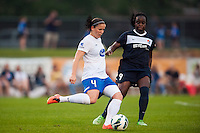 Boston Breakers defender Cat Whitehill (4) and Sky Blue FC forward Danesha Adams (9). Sky Blue FC and the Boston Breakers played to a 0-0 tie during a National Women's Soccer League (NWSL) match at Yurcak Field in Piscataway, NJ, on July 13, 2013.