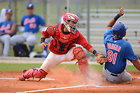 GCL Cardinals catcher Jose Godoy (54) tags a sliding Cory Vaughn (91) who was called safe on the play during the first game of a double header against the GCL Mets on July 17, 2013 at Roger Dean Complex in Jupiter, Florida.  GCL Cardinals defeated the GCL Mets 6-5 in twelve innings.  (Mike Janes/Four Seam Images)
