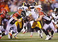 Markus Wheaton #11 of the Pittsburgh Steelers is tackled by members of the Cincinnati Bengals after catching a pass during the Wild Card playoff game at Paul Brown Stadium on January 9, 2016 in Cincinnati, Ohio. (Photo by Jared Wickerham/DKPittsburghSports)