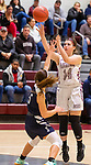 NAUGATUCK,  CT-011820JS12- Naugatuck's Alissa McNeil (14) puts up a shot over Shepaug's Haylie Lasky (25) during their non-league game Saturday at Naugatuck High School. <br /> Jim Shannon Republican-American