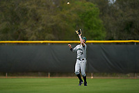 Dartmouth Big Green outfielder Kade Kretzschmar (24) catches a fly ball during a game against the Indiana State Sycamores on February 21, 2020 at North Charlotte Regional Park in Port Charlotte, Florida.  Indiana State defeated Dartmouth 1-0.  (Mike Janes/Four Seam Images)