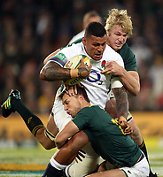 Nathan Hughes of England  is tackled by Handre Pollard and Pieter-Steph du Toit of South Africa during the 2018 Castle Lager Incoming Series 2nd Test match between South Africa and England at the Toyota Stadium.Bloemfontein,South Africa. 16,06,2018 Photo by Steve Haag / stevehaagsports.com