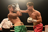 Kieran Conway (red shorts) defeats Kaan Hawes during Ultimate Boxxer III at Indigo at the O2 London on 10th May 2019