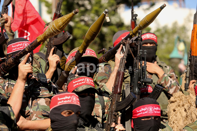 Palestinian militants of the National Resistance brigades, the armed wing of the Democratic Front for the Liberation of Palestine (DFLP), take part during a military parade against US President Donald Trump's decision to recognise Jerusalem as the capital of Israel, in Gaza city on December 9, 2017. Photo by Ashraf Amra
