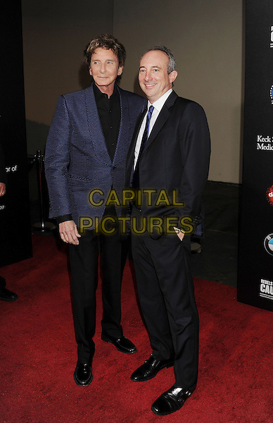 HOLLYWOOD, CA- MARCH 20: Singer/songwriter Barry Manilow (L) and author Dr. David Agus arrive at the 2nd annual Rebel With a Cause Gala held at the Paramount Studios on March 20, 2014 in Hollywood, California.<br /> CAP/ROT/TM<br /> &copy;Tony Michaels/Roth Stock/Capital Pictures