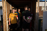 The teams waiting in the tunnel at Lye Meadow before Alvechurch (in amber) hosted Highgate United in a Midland Football League premier division match. Originally founded in 1929 and reformed in 1996 after going bust, the club has plans to move from their current historic ground to a new purpose-built stadium in time for the 2017-18 season. Alvechurch won this particular match by 3-0, watched by 178 spectators, taking them back to the top of the league.