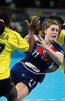 23 NOV 2011 - LONDON, GBR - Britain's Lyn Byl (#11, in blue) dives through the Angolan defence as she prepares to shoot during the 2011 London Handball Cup match at The Handball Arena in the Olympic Park in Stratford, London (PHOTO (C) NIGEL FARROW)