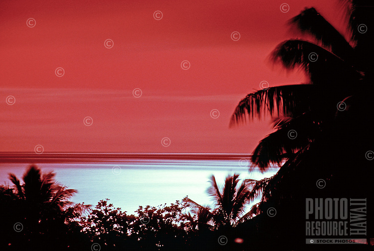 Brilliant luminous moon reflection on the ocean off Kehena Beach on the Puna Coast of the Big Island of Hawaii.