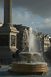 Trafalgar Square fountain with Whitehall in the distance, London UK