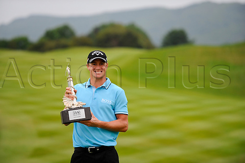 05.06.2011 Day four of the SAAB Wales Open Golf from Celtic Manor. Alexander NOREN (SWE) celebrates victory in the event with the trophy after finishing the tournament on 9 under par after the fourth and final round on the Twenty Ten course.