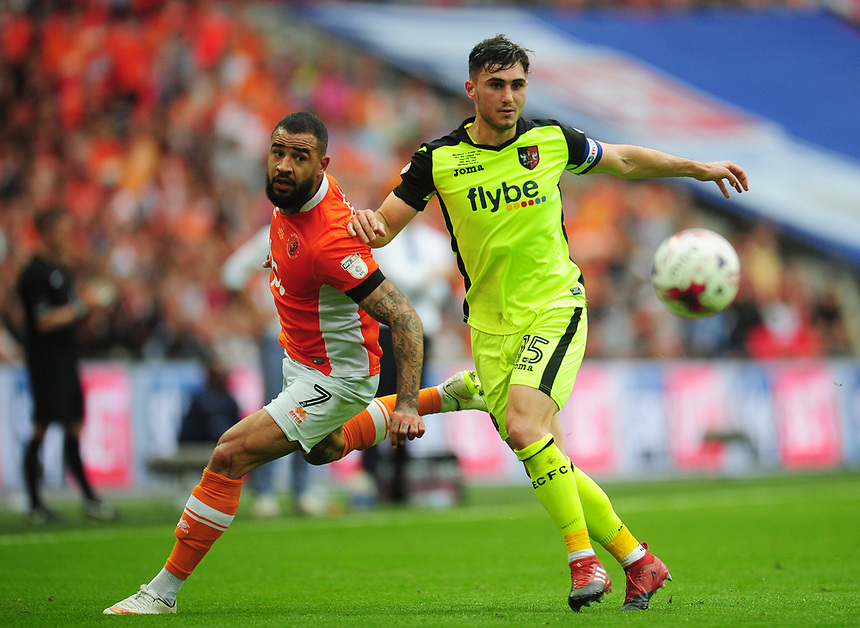 Exeter City's Jordan Moore-Taylor under pressure from Blackpool's Kyle Vassell<br /> <br /> Photographer Kevin Barnes/CameraSport<br /> <br /> The EFL Sky Bet League Two Play-Off Final - Blackpool v Exeter City - Sunday May 28th 2017 - Wembley Stadium - London<br /> <br /> World Copyright &copy; 2017 CameraSport. All rights reserved. 43 Linden Ave. Countesthorpe. Leicester. England. LE8 5PG - Tel: +44 (0) 116 277 4147 - admin@camerasport.com - www.camerasport.com