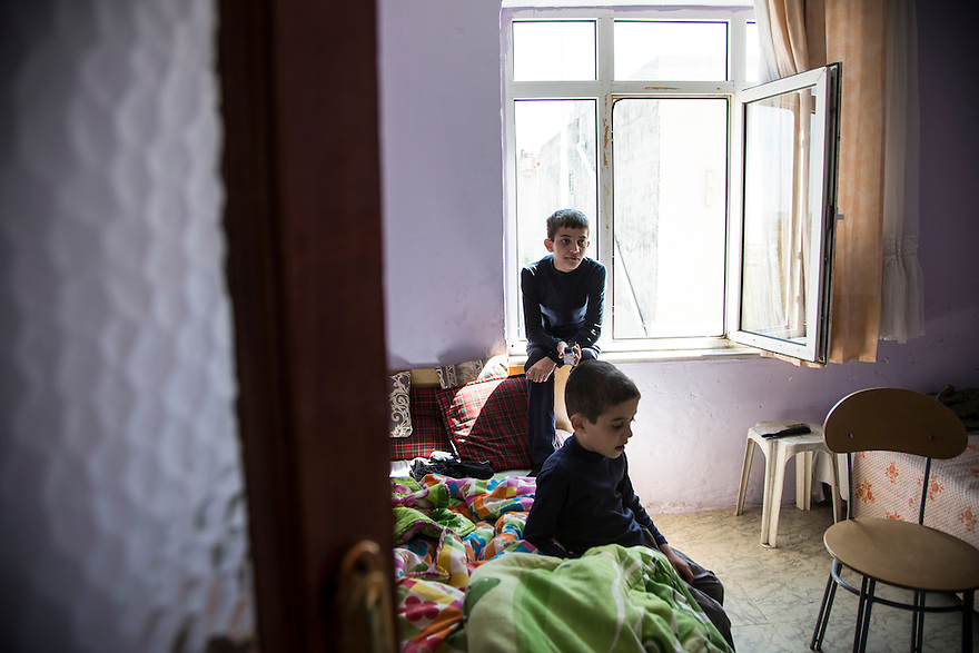 EDIRNE, TURKEY-- A Syrian Kurd family is sheltering in an apartment in a cheap neighborhood on the outskirts of Edirne and has been trying regularly to cross the border into Bulgaria.