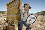 Weathered welcome sign to the town of Ione, Nev.