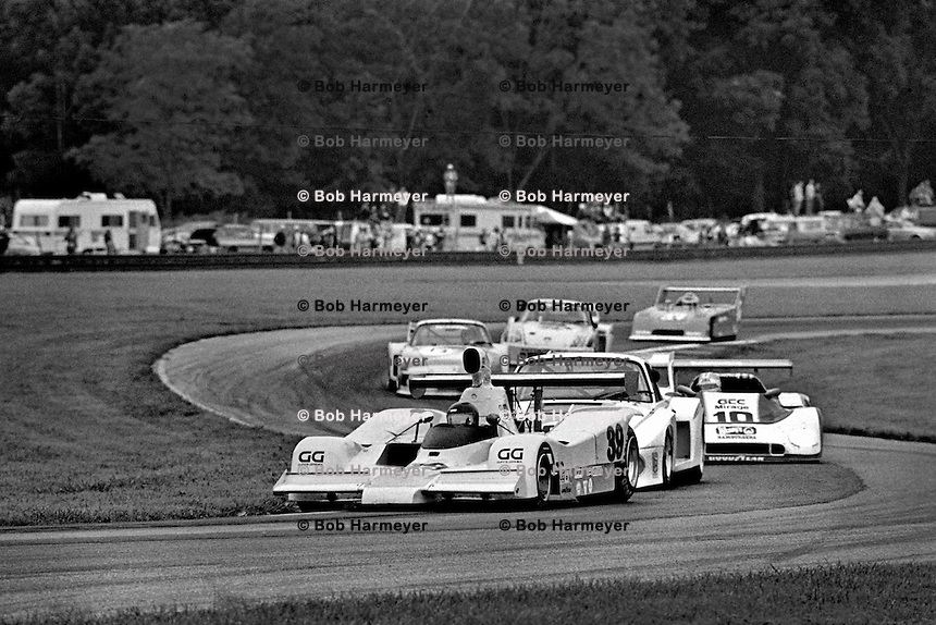 "LEXINGTON, OH - AUGUST 26: The Lola/Gp8 driven by John Gunn and Gary Belcher leads a group of cars into the ""Keyhole"" corner during the  Lumbermens 500 North American Sports Car Championship at the Mid-Ohio Sports Car Course near Lexington, Ohio, on August 26, 1979."