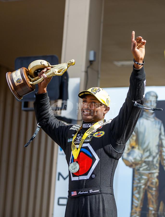 Jul 23, 2017; Morrison, CO, USA; NHRA top fuel driver Antron Brown celebrates after winning the Mile High Nationals at Bandimere Speedway. Mandatory Credit: Mark J. Rebilas-USA TODAY Sports