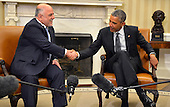 United States President Barack Obama (R) shakes hands with Prime Minister Haider al-Abadi of Iraq after a bilateral meeting in the Oval Office of the White House, April 14, 2015, in Washington, DC. The leaders discussed the strategic partnership between the two countries, support in fighting ISIL as well as commercial and cultural relations.      <br /> Credit: Mike Theiler / Pool via CNP