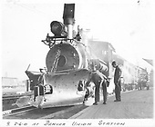 Front view of C&amp;S #9 heading a passenger train at Denver Union Station.  The engine crew is checking something on the pilot which has a small wedge snowplow mounted.<br /> C&amp;S  Denver, CO  Taken by Ashford, - 3/4/1931